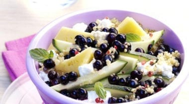 bowl of fresh fruit and vegetables with grains