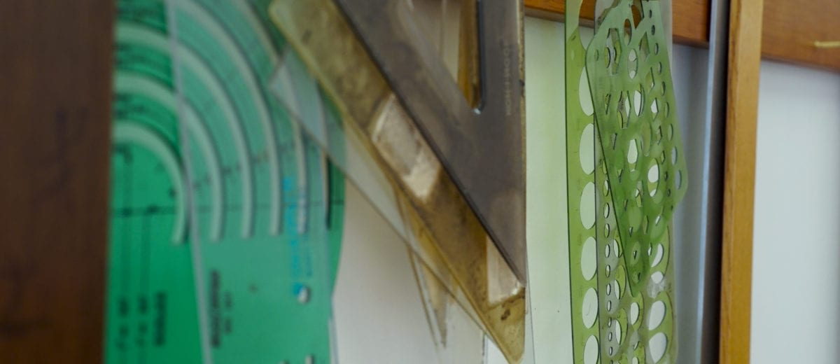 photo of rulers, clipboards, protractors and triangles