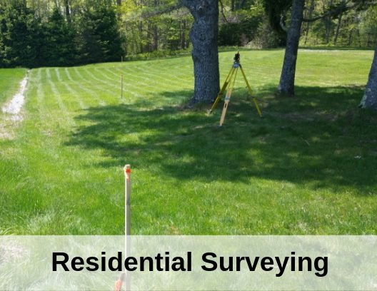 photo of Line Staking Paralax in field with the words Residential Surveying
