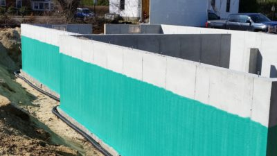 photo of waterproofing building foundation