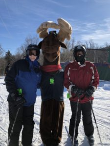 Monty Moose with skiiers